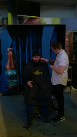Getting a hair-cut at the Mac's stand